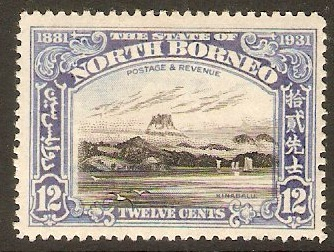 North Borneo 1931 12c Black and ultramarine. SG298.