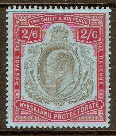 Nyasaland 1908 2s.6d Brownish blk and carmine-red on blue. SG78.